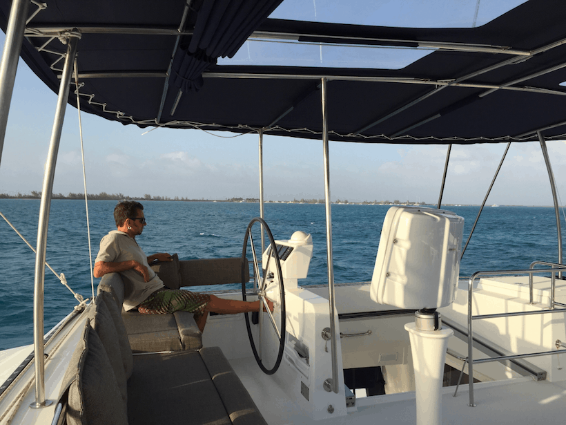 Captain sitting with his feet up aboard a yacht