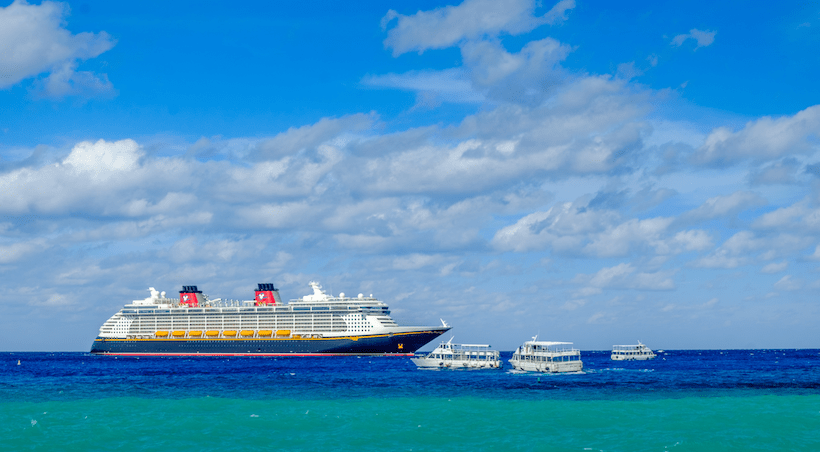 Disney Fantasy Cruise Ship with Tenders and Blue Water/Blue Sky
