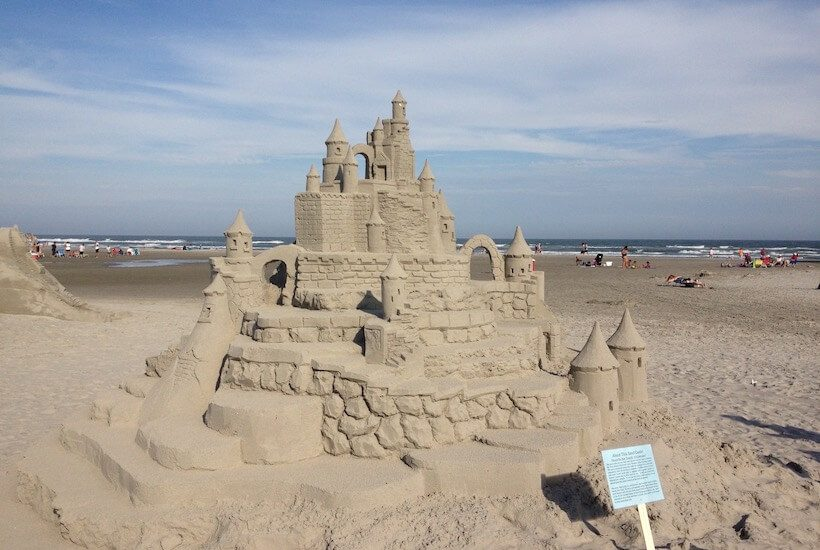elaborate sandcastle on the beach with blue sky
