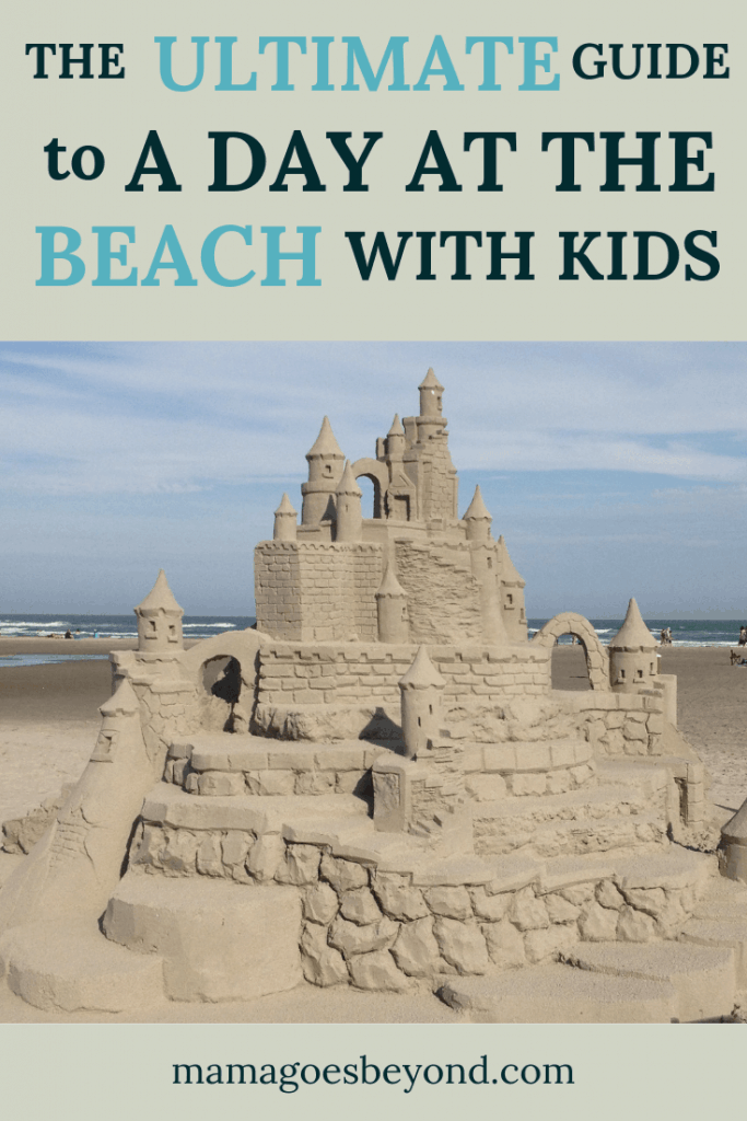 "elaborate sandcastle on the beach with blue sky with text ""the ultimate guide to a day at the beach with kids"""