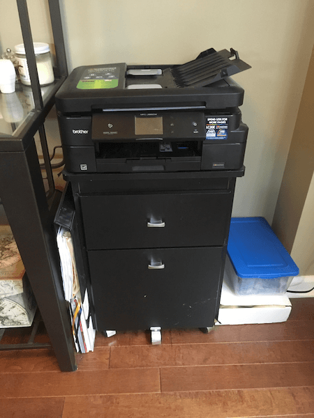 black filing cabinet, printer, and homeschooling supplies