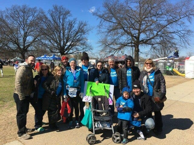 Author standing with 10 friends and family members after running the DC Rock 'n' Roll Marathon