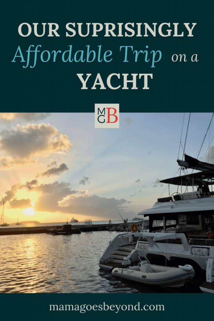 "Picture of yacht at sunset with text ""Our Surprisingly affordable Trip on a Yacht"""