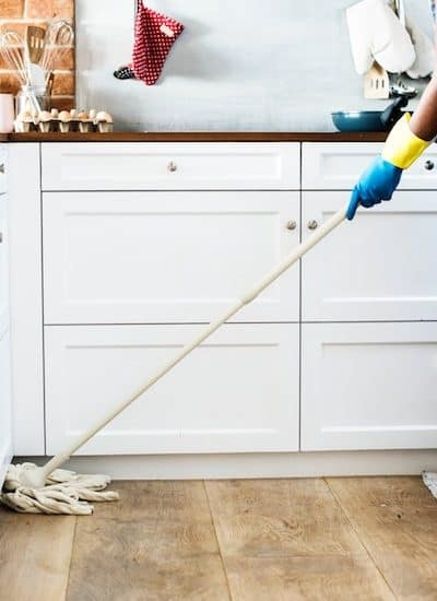 stay at home mom mopping the kitchen